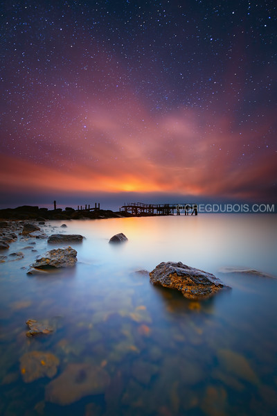 Stars and Sunrise over Decayed Pier and Atlantic Ocean in Warwick Rhode Island
