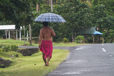 Walking man with umbrella