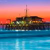 Sunset Burn over Santa Monica Pier and Pacific Ocean with Malibu Mountains - Santa Monica Beach Los Angeles County California
