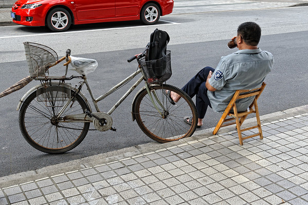 Parking assistant taking a break, Shanghai, China