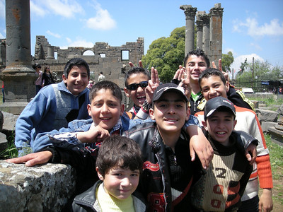 kids on a school trip at 4th - 5th century basilica ruin in Qanawat, Syria
