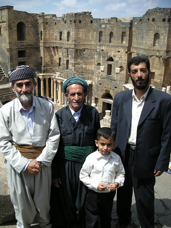 a Kurdish-Iranian family at the Roman theatre in Bosra, Syria