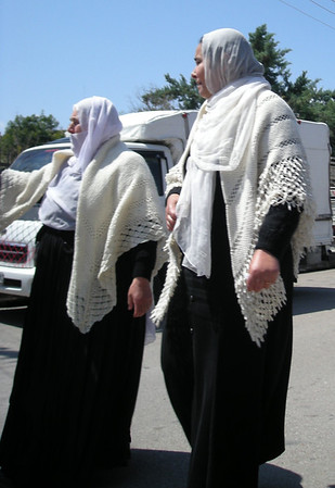 women returning after a funeral in Shaha, Syria - a small city with a large Druze community.  Similar white shawles were worn by all the women returning from the service.