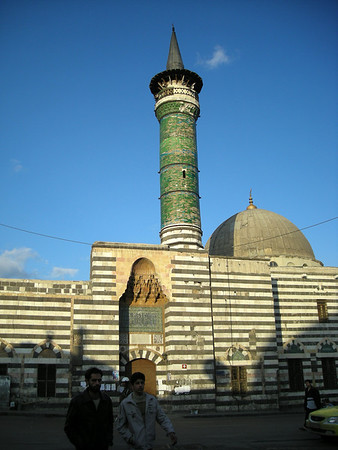 a mosque with green tiled minarette outside bab al-Jabiye, old city, damascus