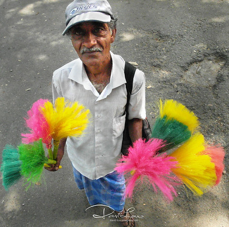 Duster seller - I was of course drawn to the multi-coloured dusters that making a shot of him was irresistible.