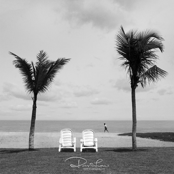 Watching the world goes by, Negombo Beach (Sri Lanka) - These beach was just besides our hotel pool. I saw the potential of this scene and dragged two chairs from the pool to make up the composition. A guy happened to passed that complete the picture.
