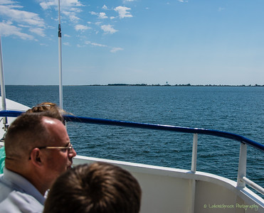 Approaching Tangier Island from Virginia. The highest land mass on the island is only 4 feet above sea level and serves as the base for the Tangier water tower.