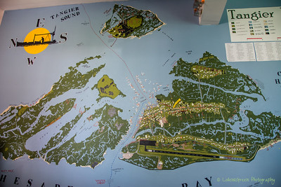 "The ""U p p a r d s ""  is the name of what use to be the city center of Tangiers Island.  It has been submerged for years.  The lighter green land masses are solid.  The darker green land represents marshes or areas that regularly flood with higher tides.  The dots on this map represent the houses and businesses that remain."