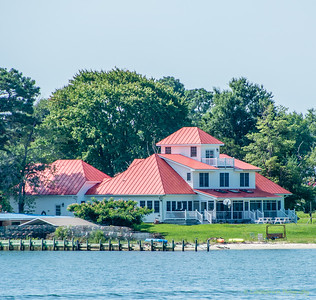 In addition to the Reedville historic district's 'Millionaire's Row of Victoria-era mansions, many more modern homes line the water passageway out of Reedville into the Chesapeake.