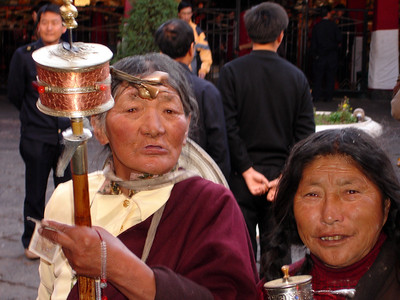 pilgrims with prayer wheels at the Jokhang Temple