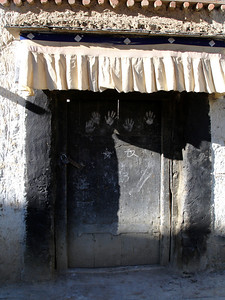 black door with hand prints in Sera Monastery