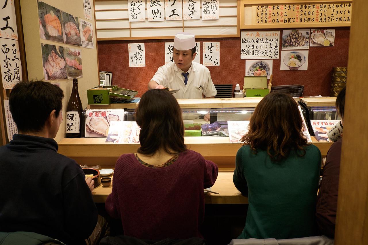 Eating sushi at Tsukiji Fish Market