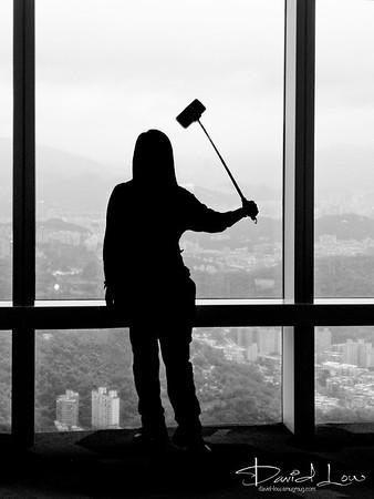 Window cleaner or taking selfie - Taipei 101 observation deck