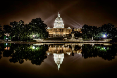 The United States Capital Building reflection.