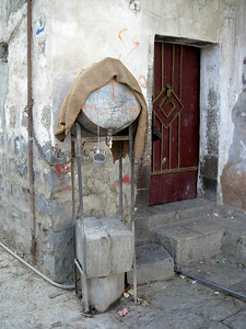 offering free drinking water at a home in Sana'a