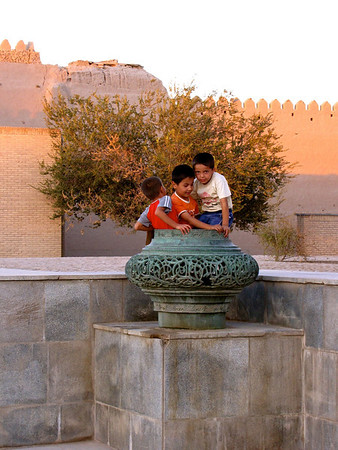 kids playing outside the old city walls in Kiva