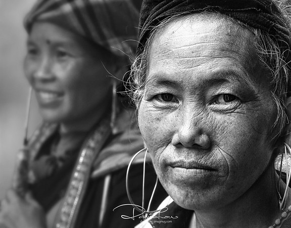 Tribeswoman - A Black Hmong tribes in Sapa Valley, her daily routine normally consists of walking a few km by tailing tourists in the hope of selling their hand-made wares.   Her weariness through these years was telling from her sedate and impassive expression.