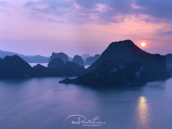 Ha Long Bay 1 - This was listed by UNESCO as a World Heritage Site with 1960 islets, most of which are limestones.  This scene supposed to be a sunset. I adjusted the in-camera colour temperature to simulate a cool sunrise !