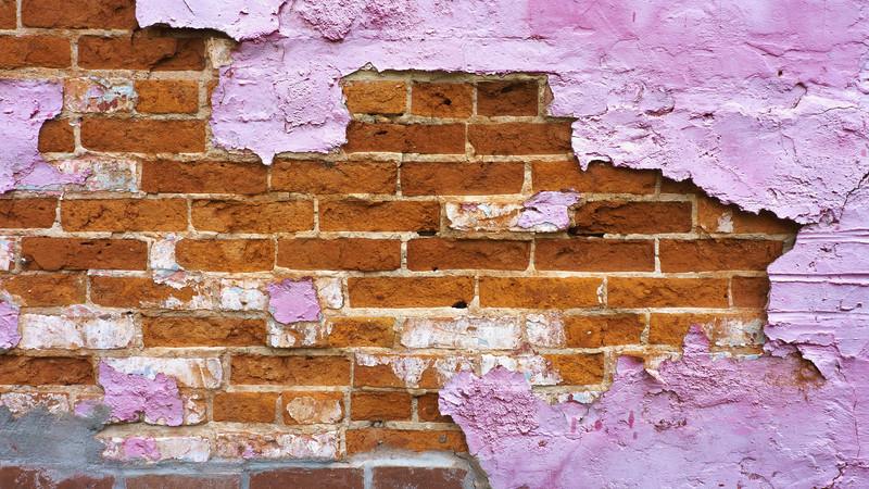 Brick wall undernearth peeling purple paint, Wilmington, Illinois