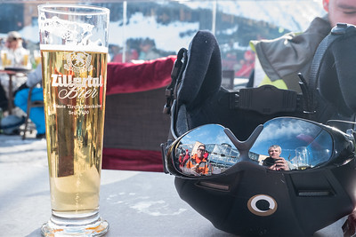 At restaurant Larmach-Alm. View to the lake beneath, skiers, instructors