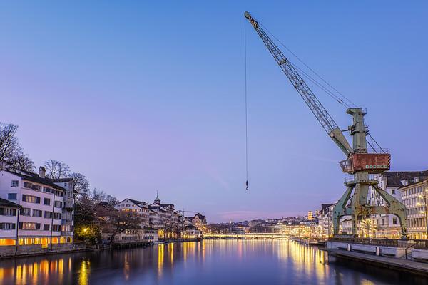 Old crane along the Limnan river, Zurich