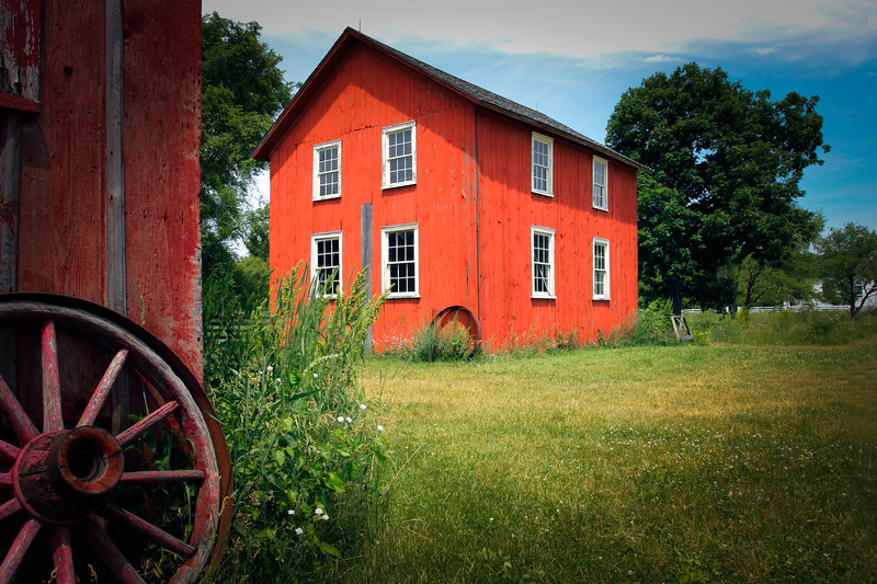 Old Red Barnyard under Summer Clear Sky