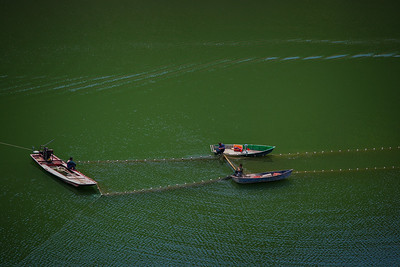 Three fishermen working together