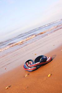 pair of sandles on beach