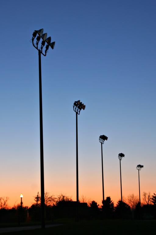 Light Poles Silhouette at Dawn