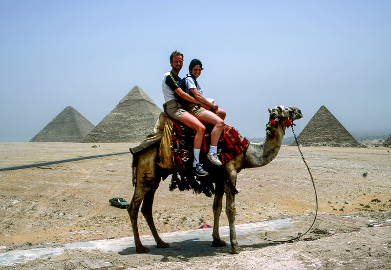 Barry & Mercedes atop camel overlooking the pyramids