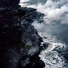 Lava flowing into the ocean & exploding into black sand