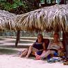 Mom & Dad under umbrella in Acapulco - 1982