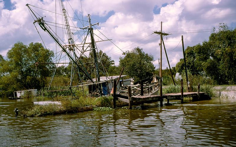New Orleans - Shrimp boat on the bayou shoreline