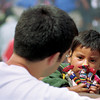 Young boy selling dolls to tourist, Chichicastenango, Guatemala