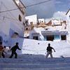Young boys play football in the street, Chefchaouen, Morocco