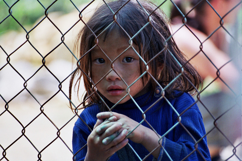 Young girl peers through fence, Sapa, Vietnam