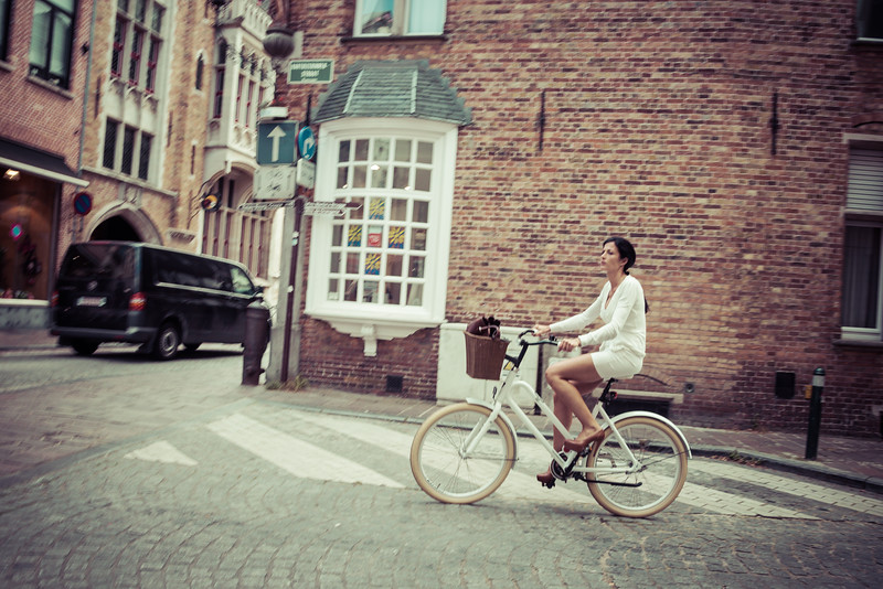 "riding a white bike in a white skirt and 6"" heels"