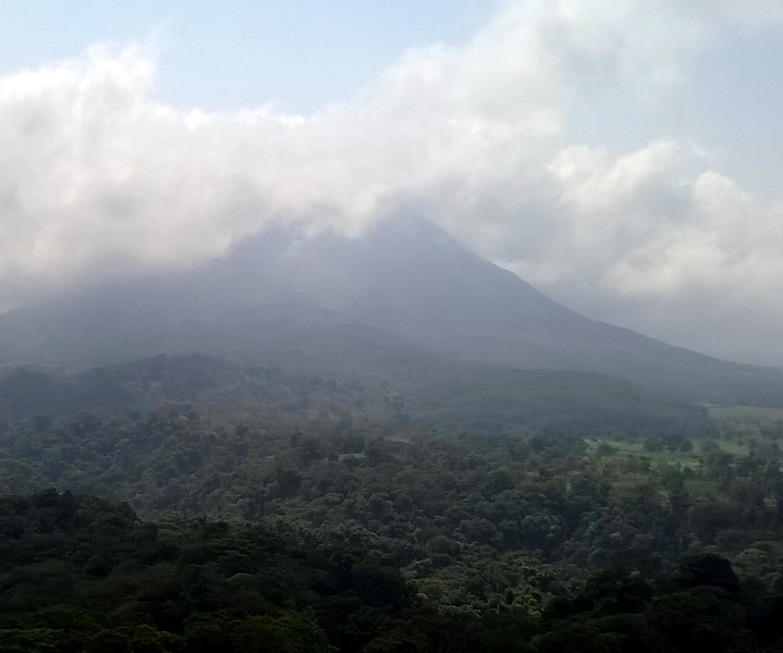 Arenal Volcano from the Swinging Bridges. Glad we had the chance to see it when it was clearer.