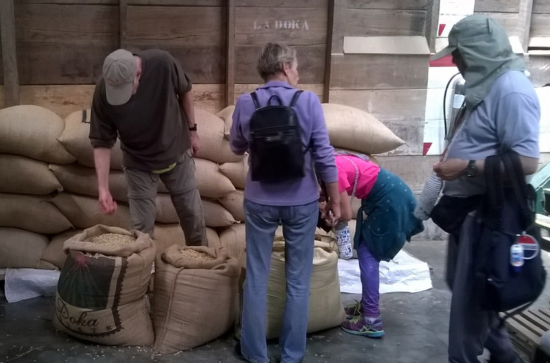 The warehouse is filled with bags of coffee beans from...