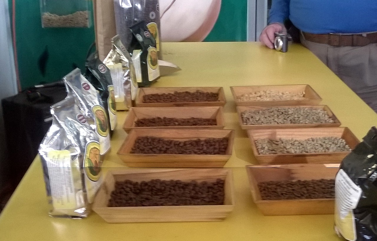 The beans are ranged from light to medium to dark roast. Trays show roasted and unroasted beans.