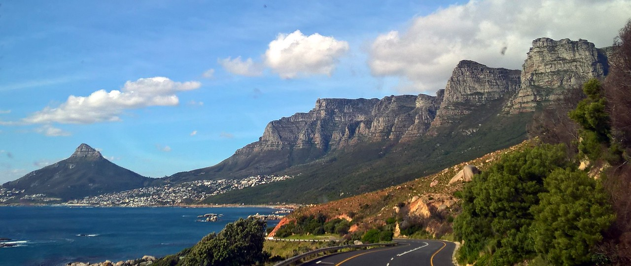 "This was the drive along the back-side of Table Mountain. The rock formations are called ""The Apostles"" although there are more than 12 of them."