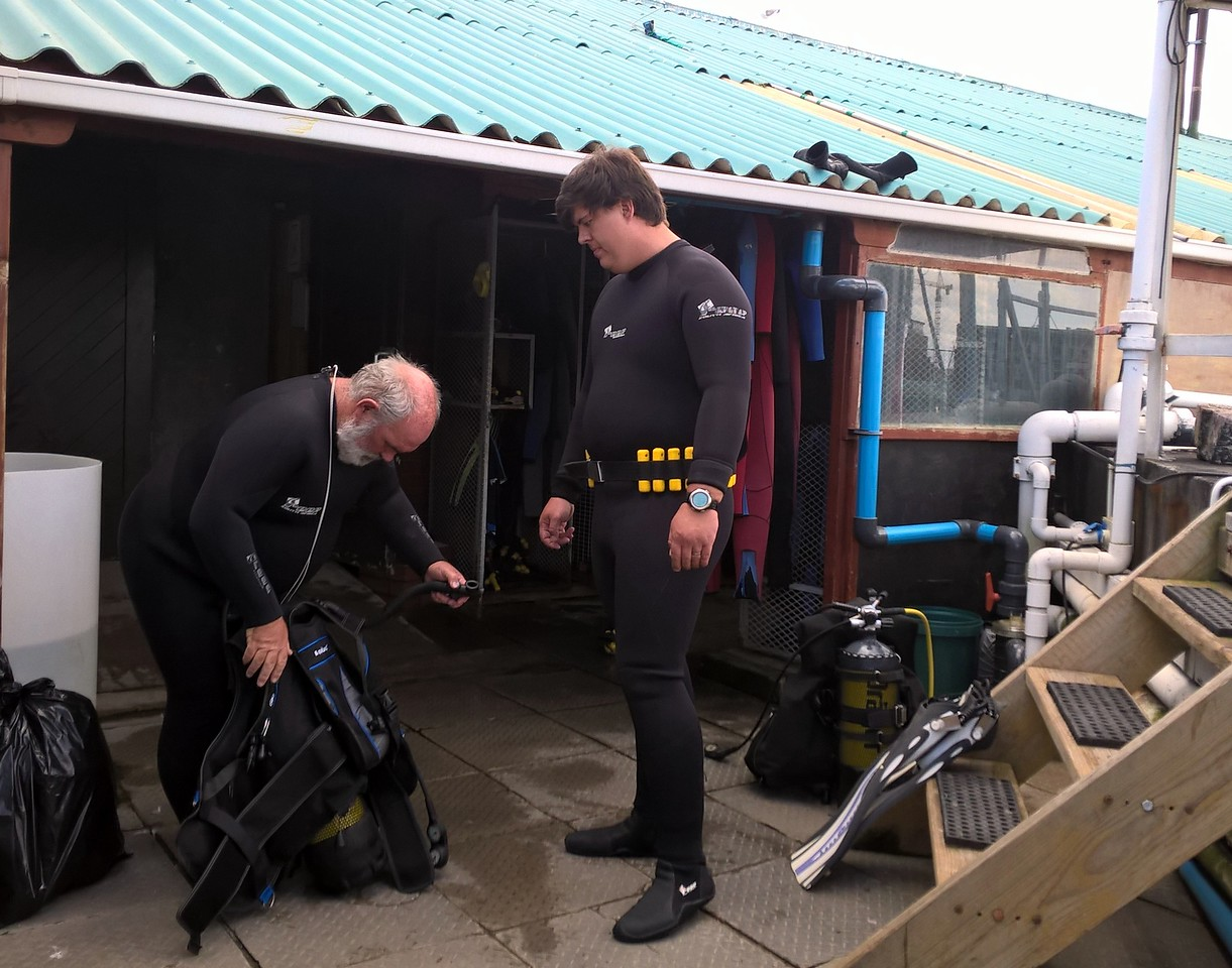 Divers preparing to go into the tank.