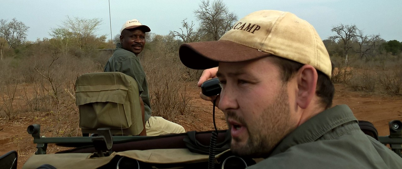 Here is Al, our guide, and Sonny Boy, our tracker. They are in touch via radio with someone who coordinates the various guides advising everyone of animal sightings and helping to ensure that everyone has an opportunity at seeing the animals.