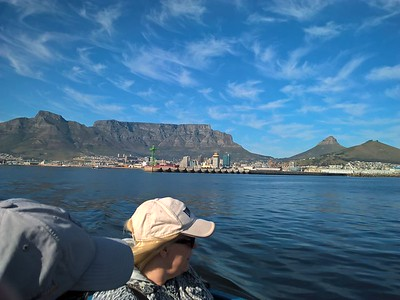 We boarded a ferry that took us over the waters to Robben Island, note Table Mountain, Lion's Head and Signal Hill looming over Cape Town.