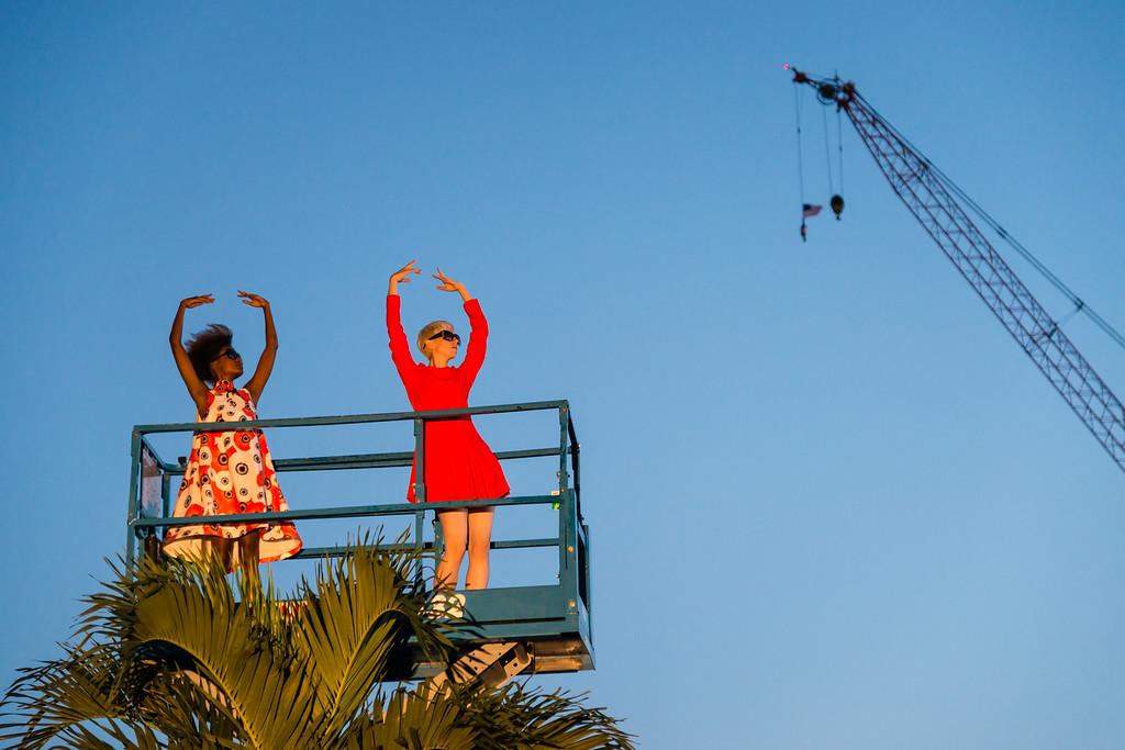Pablo Bronstein Intermezzo: Two girls wear fashion garments on a palm tree