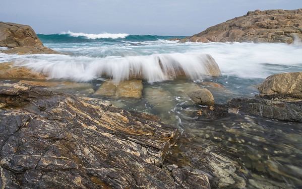 Waves breaking on the rocks, Ramsgate, South Africa.
