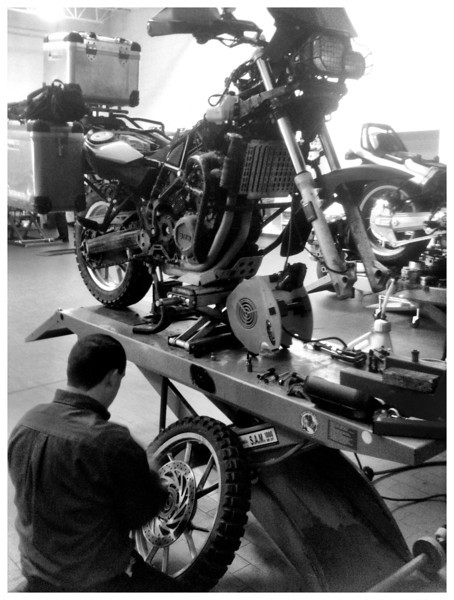My bike at the BMW place in Albuquerque getting a valve check and replacement bolts on the front rotor.  The supposedly short stop to the dealer for this valve check took just about all day.  Of course everything is just fine.  Valves are perfect.