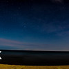 180* view of beach at night, 5 shots stitched together