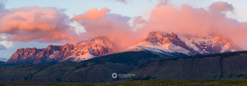 First light of sunrise hits the Andes Mountains of Patagonia