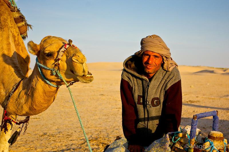 Berber guide and camel, near Douz